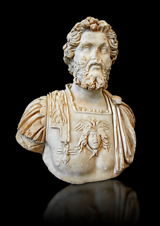 Roman sculpture bust of Septimius Severus made between 196 and 197 AD and excavated from Ostia. Severus became Roman emperor in 193 AD After deposing and killing the incumbent emperor Didius Julianus. In 202, he campaigned in Africa and Mauretania against the Garamantes; capturing their capital Garama and expanding the Limes Tripolitanus along the southern frontier of the empire. Late in his reign he travelled to Britain, strengthening Hadrian's Wall and reoccupying the Antonine Wall. Severus died in early 211 at Eboracum (today York, England), succeeded by his sons Caracalla and Geta who fought constantly until Caracalla had Geta murdered. The National Roman Museum, Rome, Italy .<br /> <br /> If you prefer to buy from our ALAMY PHOTO LIBRARY  Collection visit : https://www.alamy.com/portfolio/paul-williams-funkystock/roman-museum-rome-sculpture.html<br /> <br /> Visit our ROMAN ART & HISTORIC SITES PHOTO COLLECTIONS for more photos to download or buy as wall art prints https://funkystock.photoshelter.com/gallery-collection/The-Romans-Art-Artefacts-Antiquities-Historic-Sites-Pictures-Images/C0000r2uLJJo9_s0