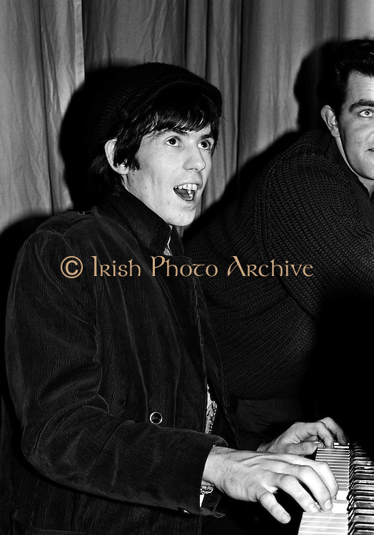 The Rolling Stones Charlie is my Darling - Ireland 1965 -..Keith Richards entertains the crowd at The Rolling Stones press conference at the Adelphi Theatre, Middle Abbey Street, Dublin. This was the band's first Irish tour of 1965....07/01/1965.01/07/1965.07 January 1965. Birthday gift ideas of a Limited Edition Prints of Keith Richards, The Rolling Stones, Charlie is my Darling, Ireland 1965. <br />