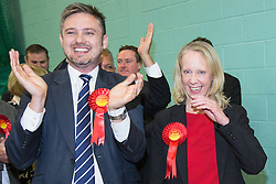 © Licensed to London News Pictures . 10/10/2014 . Heywood , UK . Labour candidate Liz McInnes with her cheering team as the result is declared . The count at the Heywood and Middleton by-election , following the death of sitting MP Jim Dobbin . Photo credit : Joel Goodman/LNP