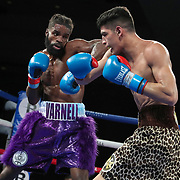 Anthony Soto (R) fights Isaiah Varnell during a One For All Promotions boxing event at the Caribe Royale Orlando Events Center on Saturday, February 20, 2021 in Orlando, Florida. (Alex Menendez via AP)