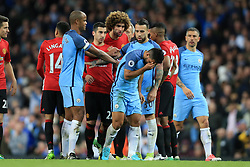 27th April 2017 - Premier League - Manchester City v Manchester United - Marouane Fellaini of Man Utd chases Sergio Aguero of Man City after being sent off - Photo: Simon Stacpoole / Offside.