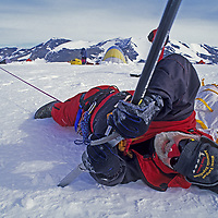 ANTARCTICA, Mount Vaughan Expedition. 88-year Norman Vaughan practices crevasse rescue technique at Patriot Hills base.