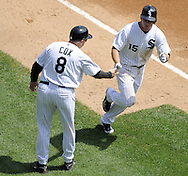 CHICAGO - AUGUST 19:  Gordon Beckham #15 is greeted by third base coach Jeff Cox #8 of the Chicago White Sox after Beckham hit a home run in the third inning against the Kansas City Royals on August 19, 2009 at U.S. Cellular Field in Chicago, Illinois.  The White Sox defeated the Royals 4-2.  (Photo by Ron Vesely)