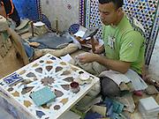Morocco, Fez, an artisan creates tile designs