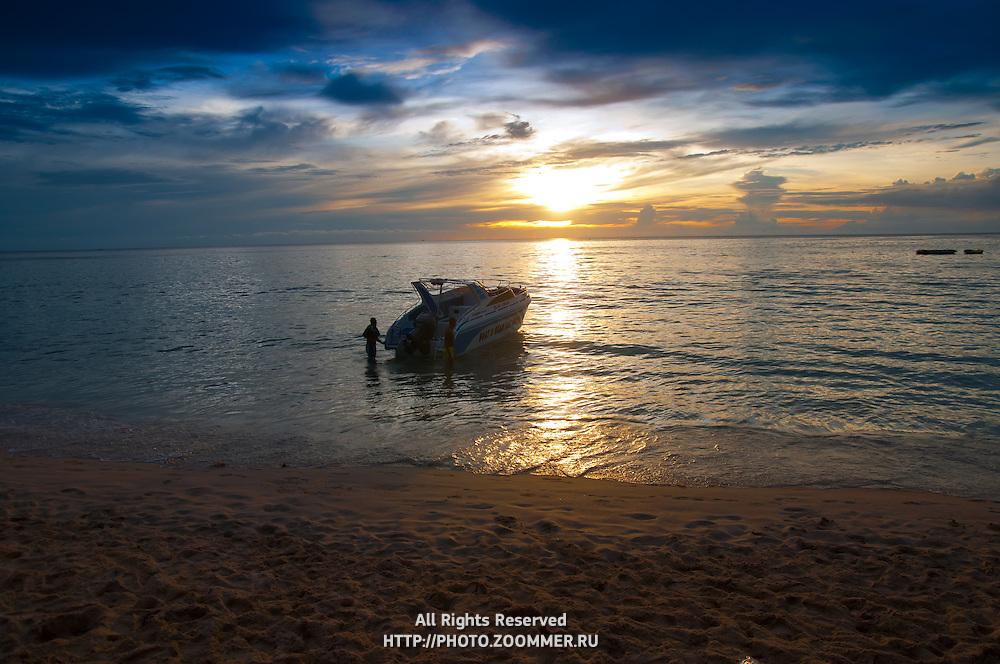 Speedboat near Phuket beach in the sunset, Thailand