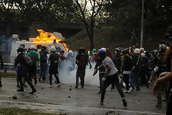 An armored police vehicle is hit by petrol bombs thrown by opposition supporters while clashing with riot police during a rally against President Nicolas Maduro in Caracas, Venezuela May 1, 2017.