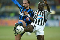 Milano 12/2/2004 Coppa Italia - Italy Cup - Semifinale <br />Inter - Juventus 2-2 (6-7 after penalties) <br />Andy Van Der Meyde (Inter) and Stephan Appiah (Juventus)<br />Photo Andrea Staccioli Graffiti