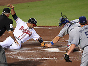 ATLANTA, GA - SEPTEMBER 02:  Shortstop Alex Gonzalez #2 of the Atlanta Braves is tagged out at the plate by catcher Rod Barajas #2 of the Los Angeles Dodgers while home plate umpire Larry Vanover #27 (left) and pitcher Chad Billingsley #58 look on during the game at Turner Field on September 2, 2011 in Atlanta, Georgia.  (Photo by Mike Zarrilli/Getty Images)