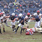 NEW HAVEN, CONNECTICUT - NOVEMBER 18:  Melvin Rouse II #7 of Yale is tackled by Luke Hutton #35 pf Harvard during the Yale V Harvard, Ivy League Football match at the Yale Bowl. Yale won the game 24-3 to win their first outright league title since 1980. The game was the 134th meeting between Harvard and Yale, a historic rivalry that dates back to 1875. New Haven, Connecticut. 18th November 2017. (Photo by Tim Clayton/Corbis via Getty Images)