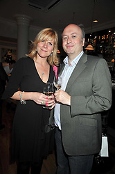 HENRY & DENISE HARRIS owners of Racine restaurant at the opening of the Brompton Bar & Grill, 243 Brompton Road, London SW3 on 11th March 2009.