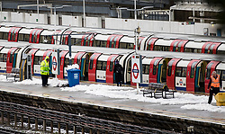 © Licensed to London News Pictures. 11/12/2017. London, UK. Tube trains wait as a snow covered Stanmore station. Disruption continues after yesterday's heavy snowfalls in some parts of the UK.  Photo credit: Peter Macdiarmid/LNP