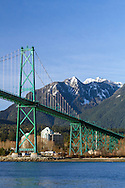 Crown Mountain and the iconic Lions Gate Bridge in West Vancouver.  Photographed from the Stanley Park seawall in Vancouver, British Columbia, Canada
