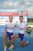 Chungju, South Korea. GBR LM2X. Bronze Medalist, left. Richard CHAMBERS and brother Peter CHAMBERS, on the awards dock, at the 2013 World Rowing Championships, Tangeum Lake, International Regatta Course.  Saturday  31/08/2013 [Mandatory Credit. Peter Spurrier/Intersport Images]