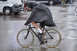 © Licensed to London News Pictures. 22/07/2017. London, UK. World class cyclists warm up ahead of the London stage of the Red Hook Criterium around Greenwich Peninsula.  Heavy rain showers made riding laps around the 1km street circuit on fixed gear bicycles with no brakes even more of a challenge as riders negotiated multiple heats to try to qualify for an evening final. Photo credit : Stephen Chung/LNP