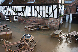 © Licensed to London News Pictures. 29/12/2015. York, UK.  Floodwater has receded around the Red Lion pub in York leaving a residue of thick mud on December 29, 2015. Further rainfall is expected over coming days as Storm Frank approaches the east coast of the country. Photo credit: Ben Cawthra/LNP