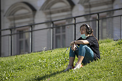 After the end of the quarantine in Italy the people begins again to working out in the city parks. In the photo: a girl is having a break in the park closer to Piazza Valdo Fusi, Turin (Italy) on May 4, 2020. Photo by Marco Piovanotto/ABACAPRESS.COM