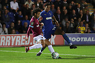 AFC Wimbledon defender Toby Sibbick (20) battles for possession with West Ham United attacker Felipe Anderson (8) during the EFL Carabao Cup 2nd round match between AFC Wimbledon and West Ham United at the Cherry Red Records Stadium, Kingston, England on 28 August 2018.