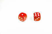 Two red dice on white background a lucky seven with a six and one
