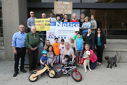 May 24, 2017 - Toronto, ON, Canada - TORONTO, ON- MAY 24  - Henning Street residents are not pleased with a development at the foot of their street. City staff have recommended approval of a tower on Eglinton Avenue. near the busy intersection with Yonge, they disregarded several of their own policies currently under fire at the OMB. Residents of the Henning Street, next to the project plan to try to have council stop the residential tower that will be as tall as the street is long, way over the mid-rise height in the official plan. in Toronto. May 24, 2017.  Steve Russell/Toronto Star (Credit Image: © Steve Russell/The Toronto Star via ZUMA Wire)