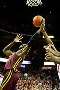 Bakary Konaté reaches up for a rebound during the second half of the University of Minnesota Men's Basketball game versus University of Wisconsin on March 5, 2017.