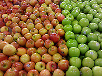 red and green apples in a supermarket