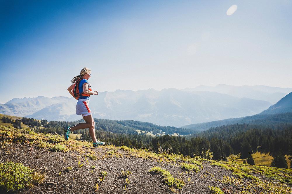 Jari Hiatt running meadows in Washington Gulch, Crested Butte, Colorado.