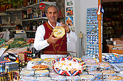 Cyprus, Troodos mountains, souvenir shop A man in traditional dress selling Cyprus delights and other candies,  sweets and nuts