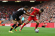 Jake Livermore of Hull City looks to grab hold of Philippe Coutinho of Liverpool. Premier League match, Liverpool v Hull City at the Anfield stadium in Liverpool, Merseyside on Saturday 24th September 2016.<br /> pic by Chris Stading, Andrew Orchard sports photography.