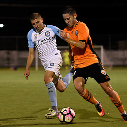 BRISBANE, AUSTRALIA - DECEMBER 22: Connor O'Toole of the Roar dribbles the ball during the round 4 Foxtel National Youth League match between the Brisbane Roar and Melbourne City at AJ Kelly Field on December 22, 2016 in Brisbane, Australia. (Photo by Patrick Kearney/Brisbane Roar)