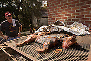 Pit master roasts a pig at Honey Horn Plantation on Hilton Head Island, SC