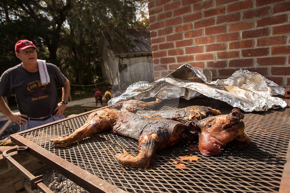 Pit master roasts a pig at Honey Horn Plantation on Hilton Head Island, SC