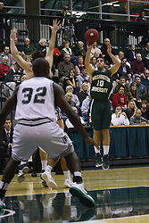 17 December 2011:  Alan Aboona shoots an uncontested three point shot during an NCAA mens division 3 basketball game between the Washington University Bears and the Illinois Wesleyan Titans in Shirk Center, Bloomington IL