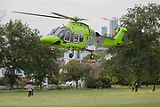 A Childrens Air Ambulance takes-off from Ruskin Park in Lambeth, south London, on 21st June 2019, in London, England. The AgustaWestland AW169 helicopter G-TCAA is operated by used by UK Air Ambulances Specialist Aviation Services whose UK headquarters are at Gloucestershire Airport in England. It was built in 2016.
