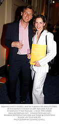Ballerina DARCEY BUSSELL and her husband MR ANGUS FORBES, at a reception in London on 24th April 2003.PJA 37