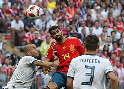 MOSCOW, July 1, 2018  Diego Costa (C) of Spain competes for a header during the 2018 FIFA World Cup round of 16 match between Spain and Russia in Moscow, Russia, July 1, 2018. (Credit Image: © Cao Can/Xinhua via ZUMA Wire)