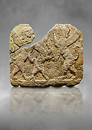 Hittite relief sculpted orthostat stone panel of Herald's Wall Limestone, Karkamıs, (Kargamıs), Carchemish (Karkemish), 900-700 B.C. Anatolian Civilisations Museum, Ankara, Turkey.<br /> <br /> Two sphinxes standing on their hind legs on both sides attack to the winged horse standing on its hind legs in the middle.  <br /> <br /> Against a grey art background. .<br />  <br /> If you prefer to buy from our ALAMY STOCK LIBRARY page at https://www.alamy.com/portfolio/paul-williams-funkystock/hittite-art-antiquities.html  - Type  Karkamıs in LOWER SEARCH WITHIN GALLERY box. Refine search by adding background colour, place, museum etc.<br /> <br /> Visit our HITTITE PHOTO COLLECTIONS for more photos to download or buy as wall art prints https://funkystock.photoshelter.com/gallery-collection/The-Hittites-Art-Artefacts-Antiquities-Historic-Sites-Pictures-Images-of/C0000NUBSMhSc3Oo