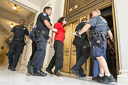 July 19, 2017 - Washington, District Of Columbia, U.S. - United States Capitol Police officer load protestors into an elevator after their arrest for protesting in the Russell Senate Office Building on Capitol Hill. The protesters oppose a senate republican effort to repeal and replace the Affordable Care Act also known as Obama Care. (Credit Image: © Alex Edelman via ZUMA Wire)