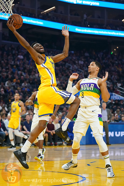 February 23, 2020; San Francisco, California, USA; Golden State Warriors guard Andrew Wiggins (22) grabs a pass against New Orleans Pelicans guard Josh Hart (3) during the first quarter at Chase Center.