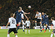 Michael Keane of England battles with Lukas Podolski of Germany for a header during the International Friendly match between Germany and England at Signal Iduna Park, Dortmund, Germany on 22 March 2017. Photo by Phil Duncan.