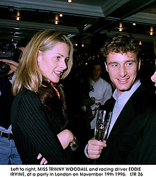 Left to right, MISS TRINNY WOODALL and racing driver EDDIE IRVINE, at a party in London on November 19th 1996.<br />   LTR 26
