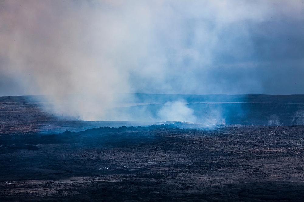 Steam and gases drift up and out of the bubbling lava lake in Kilauea Caldera / Halema'uma'u crater April 2017, Hawai'i Volcanoes National Park, Hawaii, USA.