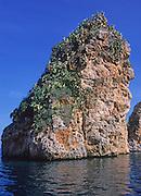 Limestone rock stacks stand in blue Tyrrhenian sea, Scopello, Sicily, Italy