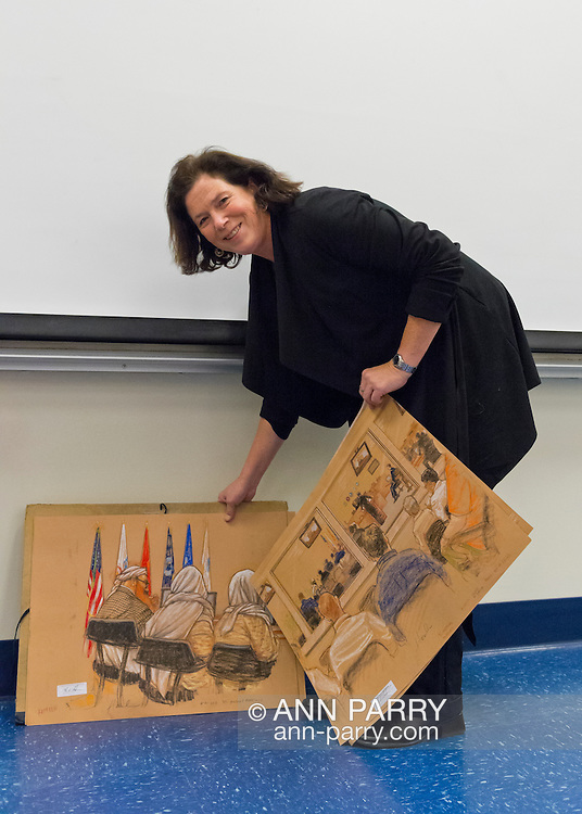 """Hempstead, New York, U.S. 12th November, 2013. Janet Hamlin, a courtroom artist covering the military tribunals at Guantanamo Bay since 2006, shows her charcoal drawings and discusses her work at Hofstra University. Much of the time she was the only journalist providing a visual record of the events at the United States naval base in Cuba, and her new book """"Sketching Guantanamo"""" is a collection of her images."""