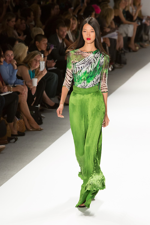 Bright green trousers in a Fortuny-esque fabric, with bell-bottoms and a jungle-print top in green, white rand black. By Carlos Miele at the Spring 2013 Mercedes-Benz Fashion Week in New York.