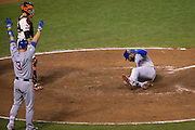 Chicago Cubs catcher David Ross (3) celebrates as right fielder Jason Heyward (22) slides into home plate for a run during Game 4 of the NLDS against the San Francisco Giants at AT&T Park in San Francisco, Calif., on October 11, 2016. (Stan Olszewski/Special to S.F. Examiner)
