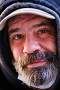 """16 FEBRUARY 2021 - DES MOINES, IOWA: A homeless man in an alley in downtown Des Moines. Iowa, like much of the United States, is in the grip of a frigid Polar Vortex. Temperatures in Iowa have been 30F below normal for more than a week. Tuesday morning, 15 February, was the coldest morning so far and is expected to be the coldest morning in central Iowa this winter. The temperature in Des Moines was -17F (-27C), with the windchill factored in the """"feels like"""" temperature was -25F  (-32C). Schools have been closed for the last two days so students wouldn't have to stand outside waiting for buses. Most outdoor activities, like outdoor construction and road work, are paused until temperatures rebound. The public libraries, closed because of the Coronavirus pandemic, were opened as warming centers, and the city buses were free so people could ride the buses to stay warm.      PHOTO BY JACK KURTZ"""