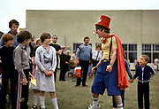 Lenny the redcoat, entertaining the kids, Butlins holiday camp, Skegness. Butlins Skegness is a holiday camp located in Ingoldmells near Skegness in Lincolnshire. Sir William Butlin conceived of its creation based on his experiences at a Canadian summer camp in his youth and by observation of the actions of other holiday accommodation providers, both in seaside resort lodging houses and in earlier smaller holiday campsThe camp began opened in 1936, when it quickly proved to be a success with a need for expansion. The camp included dining and recreation facilities, such as dance halls and sports fields. Over the past 75 years the camp has seen continuous use and development, in the mid-1980s and again in the late 1990s being subject to substantial investment and redevelopment. In the late 1990s the site was re-branded as a holiday resort, and remains open today as one of three remaining Butlins resorts.