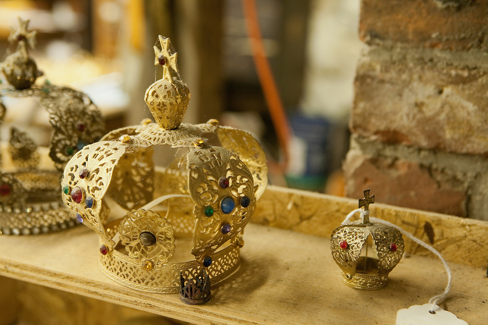 Sample crowns of various sizes gather dust on a shelf.