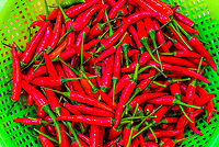 Red chiles, outdoor market, Central Market, Hoi An, Vietnam.