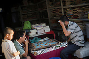 Chinese men play typical Chinese chess called mahjong in a shop in Pingyao, China, July 30, 2014.<br /> <br /> Food and games are a real pleasure for the life of Chinese community. <br /> At home, in the streets, at the park or in restaurants, the chance to find someone eating or playing is considerably high.<br /> <br /> © Giorgio Perottino
